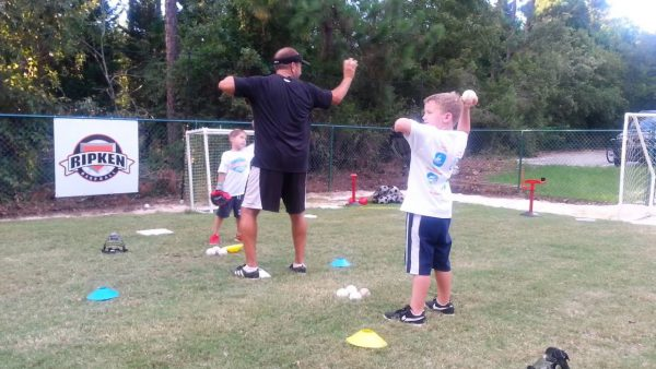 10 years is about the right age to let a kid start his baseball practice. At this age, he would start swinging and learn the throwing mechanics. Prior to this age, you can familiarize the kids with the game's rules. You can also get the child to learn the value of working as a team and boost positivity. Now is the time they start learning skills. And for that, we have composed a list of 8 drills that can help a 10-year-old be better at the game. These skills are exclusive and are different from the ones you would see adult players practicing or very young kids doing. A 10-year-old might have uncorrected or unchecked habits that might be an impediment in the path of their baseball practice. However, it is not too late. You can start at this age to tune them around the needs and requirements of the game. You can demonstrate the basics of how to run, throw, swing, or catch. A 10-year-old child understands the rules. He will be quick to pick up the drills and use them during actual gameplay. A young child might now show interest in knowing all the aspects of a smooth swing. Hence, the coaches must ensure that they hit the perfect load, swing, and slide. Once they have a good grasp, make them repeat the drills to build muscle memory. These drills are designed to enable a 10-year-old to develop footwork and exercise their legs and feet. If kids repeat these drills ample times, it will develop great fielding habits by getting stored in muscle memory, then enables him to use it automatically when he requires it. Home Run Derby Drill – Batting Tee or Soft Toss You can let the 10-year-old start on a more liberal plane by letting him hit the baseball to the best and the farthest he can by using a tee or a wiffle bat. Make the kid practice this drill even before you give him any lesson on swinging mechanics. After the child practices enough open hitting, the coach and parents must take special note of the child's posture, the way the child strides and loads, and other technicalities of a perfect swing. For this drill, using tennis balls and wiffle bats will work the best. However, at first, you will have to search for an open field. Your backyard should do fine if it has enough space. The idea is, the location should have enough space where the kid can hit the ball freely. Create a home plate of 17 inches wide by using chalk. If you are not a fan of drawing on the ground, you can create it by using a few sticks to form a rope demarcating the plate. · Soft Toss: To train your child, you will have to own about one dozen tennis balls or whiffle balls. Stand at a close distance and make a soft toss at him. Stand and observe how the kid goes about hitting it. Notice whether the player makes any faulty movement with his feet or legs and instructs him to change it. Toss five to ten wiffle balls or tennis balls one after another and allow your child to try and hit them. · Batting tee: Hitting the ball from on top of a batting tee is somewhat easier. Parents buy a good quality batting tee for this purpose. Then adjust its height such that the baseball stands at the kid's waist level. Let your 10-year-old swing about five to ten balls before ascertaining his lacunas, strengths, and area for improvement. First Batting Tee Drill When you let a kid use a tee, more often than not, he will only observe the results of his hit. He is most likely not to take notice of the actions that are behind the results. Hence, often the child might be using the wrong technique to get the desired results. This might hamper his posture or his overall gameplay. But the kid's eyes are generally fixed on the distance the tennis ball travels as a result of his swing. For this reason, many coaches prefer the kids to practice in a batting net. With a net in front, the ball cannot travel further than a stipulated distance. This takes the focus off of the results and makes the kids concentrate on the swing techniques. He learns about his form better, and later on, he can apply this knowledge during a game or during his practice sessions. The batting tee has several advantages. With its help, you can let a hitter get to practice in low and high pitches. If he wishes, you can as well throw to outside or inside of the home plate. Repetition of drills is beneficial in the development of batting skills. For developing it, the coach can place the tee inside the plate. The hitter gets into a ready position and swings 100 balls inside of the plate. A beginner should swing about 100 balls into the net in each of the cases. They must start with inside pitches, then move onto the outside, followed by high pitches and low ones. The repetition will form muscle memory and become an ingrained part of the player's system. This will be of help when the kid is playing a real baseball game. There can be circumstances when his mind is not sure of the stride, but this muscle memory will come to the rescue and make him do the right thing. The coach bears the responsibility to train the kids in a way such that they can hit the ball in all types of pitches. Reputation is good, but not the ones that take away variety. Hence the coach must change the batting tee's position every now and then so that the players can be thoroughly trained in all types of pitches. It is best to designate a certain time for the kids to practice in each kind of pitch. There would be a specific time duration for the player to bat the inside pitched ball, followed by outside pitch, then low, and it culminates with the practicing in high pitch. Load to Launch Batting Tee Drill for 10 years old There exists no such thing called ''perfect stance''. The stance, which makes a hitter feel most at ease, is right and perhaps the best for him. However, there is a certain set of swing mechanics that batters must learn if they have to ace the game. There are three parts to batting mechanics. First is the 'batting stance.' It is the posture that a hitter stands in for hitting the ball. The second is 'the stride,' which means preparing himself for hitting the ball, and finally, the third is 'follow-through,' which helps in maintaining the flow that makes swing smoother. Setting up This is the initial stage. Here the hitter stands out of the batter's box. He first takes five to six swings in the air. Which means, there would be no ball included. The practice swings let the batter's muscle to prepare for the actual ball he would be hitting in a short while. You can simply call this the warm-up session. This also makes the player more prepared and focus on the game. This relaxes the mind and brings in the concentration that a player needs to be the best. The two major components of excellent batting are mindset and muscle memory. You can get your kid to muscle memory by making them practice the drill over and again. And a mindset is formed when you give them about 30 secs or so to swing their bats and get into the form. Approaching the Tee The batting stance of a hitter falls under the realm of individual choice. The main purpose of making the kids practice with a betting tee is to improve their load and stride. When you begin, do not place a ball on the tee. Instead of that, you let the batter grab the bat and explain to him the dynamics behind a load. You let him know that 'load' is actually a process of harnessing energy, which you transfer to the bat while hitting—the legs, hips, and feet functions in sync for a good loading. After explaining, you teach the child to load his legs on all types of pitches. Instruct the player to go for 20 swings without placing any ball on the batting tee before hitting any shot Load and launch When the player focuses on his lower body, it will inevitably put a stop to the unnecessary shoulder movement. As this is just the first step, focusing on the lower body is more necessary than focusing on perfection. You just need to ensure that the player's swing employs the lower part of their body. As they practice more, their game would improve. If they have any minor imperfection, with age and practice, things will be set right as muscle memory takes over that automatically makes him take the right action on the field. Warm Up Batting Tee Drill At the time when a young baseball enthusiast reaches the age of 10, he can do way more than merely connecting the bat to a ball placed on the batting tee. Now is the time to start doing some special practices. He can start hitting the ball on the outside and inside pitches. He can start to hit balls that are at his knee level and also the ones that are higher. The player can as well try hitting for power. This drill focuses on loosening up the muscles and will work great if individual players, as well as groups, practice it right before their practice sessions or games. It will loosen up the muscles of players' feet, hips, arms, legs, and shoulders. Start the drill by taking 15 smooth swings. At this stage, the players are just warming up. So, try to avoid doing anything intense. Instead, concentrate on your swing, your posture, and loading and striding. Now, the players isolate their lower body for the swing. They get the knees, legs, and feet to fall into certain sync that enables them to load better. Players can imagine the pitcher to be about 60 ft away. Players should align their feet to the tee, in a similar fashion, they would align their body if the ball was being pitched. While you are swinging the bat, imagine that the baseball is being pitched by a pitcher. Now, focus on the follow-through and maintain a string of smooth and well-played swings. Each player should do this ten times. Outside Pitch Batting Tee Drill If you want your baseball-loving kid to learn how to take a swing at the outside pitch, then you better get them practicing this drill. The case with the outside pitch is, when the batter swings smoothly, the ball will straightaway fly to the other end. You can relocate the tee towards the back of the home plate. Now stand back and allow the player space where he would be able to take a swing at the outside pitch. He should maintain his stance such that his feet line up with the home plate. For this, players might have to move four inches forward-facing the pitcher. When the ball is pitched, make a powerful swing. Generally, while playing outside pitched ball, the players have a tendency to slag. So, to cut away from this general tendency, it is best to practice hitting hard for the outward pitched ball. You can think of it to be a hit & run baseball drill. Just stay atop of the baseball when it is pitched. Then it hard downwards in the direction of the opposite field. The player maintains his stride but doesn't stride towards the opposite pitch While hitting, the head of the bat has to be behind your hands. The player's bat has to contact the baseball before the bat entirely crosses his home plate. If the player swings early, then the ball heads towards the opposite field. It means, if the player is a lefty, the ball flies to the left side. If the player is a righty, the ball goes to the left. To play an outside pitched ball, the player must ensure that his back foot and hips are facing the opposite direction. If the player is right-handed, his feet and hips face towards the left side. If he is left-handed, then his feet and hips would be in the right direction. When playing an outside pitched ball, players need to keep their bats at a level. If they drop, it might affect the gameplay. Batting Tee Drill for Hitting Inside Pitches For hitting an inside pitch, you want your hands to be tight on your body. It is typically a hit for which you will need to master load and unleash it when the ball comes in contact. If you are right-handed, try pulling the baseball on to your left side. If your left hand is the dominant hand, then you will have to do the exact opposite, i.e., get the ball o to the right side. In the case of many fielders, they do the inside-out tactics on getting jammed. This will cause the ball to go to the other end in a feeble manner. If you can pull in at the right moment, using the correct techniques, then your swing will be laden with a better punch, causing the ball to go farther. Setup: Place the front foot slightly ahead of the tee post. Move a tad closer, such that when you face an inward pitch, you hit the baseball with the thickest part of your bat. For playing an inward pitch, you will first have to take your stance, and practice swinging in the air. Train yourself in a way that the ball contacts the thickest part of your barrel. For this end, swing in a way so that the ball placed on the batting tee always comes in contact with the barrel's thick part when you hit it. However, always remember, if your barrel is very close to your hand, it might lead to a foul tip, or the ball might go off as a weak ground ball. To play inside the pitch ball, keep your hands closer to your body. To play this pitch in an efficient manner, hold your bat in a way such that its head is ahead of your hands. When you are taking a swing, try hitting the ball in the direction of the power alley. Try so that the ball comes in contact with the thickest part of your barrel. Try to maintain calm of mind and body. This helps you to follow through. In case the ball does not pull as you want it to, move away from it. Footwork Fielding Drills – Ground Balls This particular drill is useful for fielders and focuses on footwork that is helpful for fielding grounders. Generally speaking, young kids of 10 years are generally more into using their shoulders and arms when it comes to fielding. If you get the young players to practice this drill, it will make them focus more on the footwork and help the way they go about fielding. You do not need any special prop for this drill; just a ball will suffice. The coach and the player start on the infield dirt, and the coach will roll soft grounders in his direction. This drill gets the 10-year-old to make body movements in a sideway direction. First, roll a slow ball slightly towards the right side of the player. The player moves towards the right in a manner that the baseball passes right through between his legs. Here the players don't really field or retrieve the ball. In a similar fashion, roll a grounder in the player's left direction. The player then moves his body in the left direction, such that the ball passes through the legs. You will have to gradually increase the intensity by either increasing the speed or the force. Either way, the goal of this drill is to make the player move faster from one side to the other so that he gets in the position quickly enough for the ball to pass through the gap of the legs. This exercise is super effective in teaching young kids to face the ball. Repeating this drill will create muscle memory that will help the player later while fielding. This baseball drill for a young player is very beneficial. To make it more enjoyable, you can give it the shape of a competition if you are practicing with the whole team. Traffic Cone Goalie Drill First, position two cones at a distance of 5 or 6 yards on a surface that imitated infield dirt. It is best if you can practice this drill on an actual baseball ground. If not, any resembling surface should do. This is an exciting drill that a 10-year-old would like. While training young players, it is best to represent these drills as fun. These drills are designed in a way that they help in building muscle memory. They would be of help when the kid goes off to play college baseball or school baseball. For this drill, the coach rolls ground balls in between traffic cones, or he might use a fungo bat to do the same. Start off by throwing a rapid-fire ground ball in the direction of the player. The intention here is to challenge the player. Hence, the pace should be high. The player will have to get hold of the ground ball anyhow. He can do it backhanded or by wearing a glove. Mix it up a bit. For instance, you can hit a few balls that let him catch them forehanded. Then just to shake him off the path, hit another one that he has to catch backhanded. You can gradually expand the distance between the two cones, until a point where the young player can no longer run back and forth where he can no longer retrieve the grounder in the glove. If you are practicing with the whole team, then you might make it even more fun by making it a competition. Get the players in line and ask them to observe the first one who goes out to the field. Now keep a count of the balls that each of the players is able to field. The one with the maximum count wins.